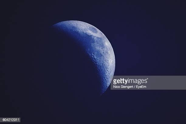 Low Angle View Of Half Moon Against Sky