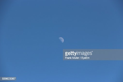 Low Angle View Of Half Moon During Day