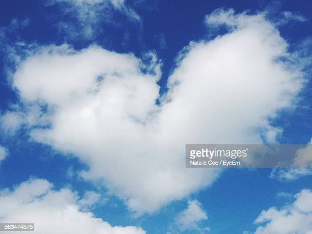 Low Angle View Of Heart Shape Cloud In Blue Sky
