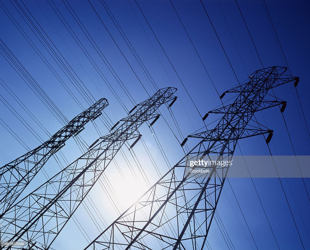 low angle view of high tension cable towers : Stock Photo