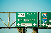 Low angle view of highway signs to Hollywood, Los Angeles, California, USA