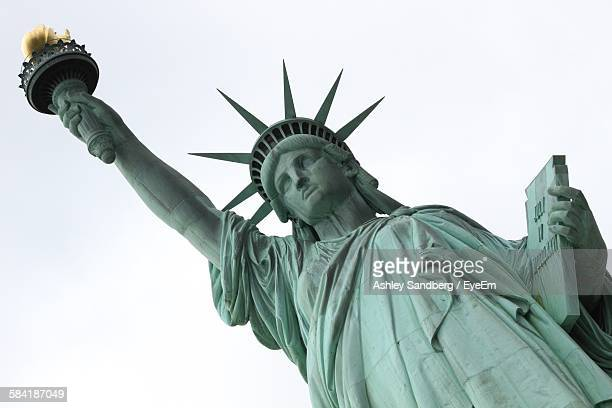 Low Angle View Of Historic Statue Of Liberty Against Sky