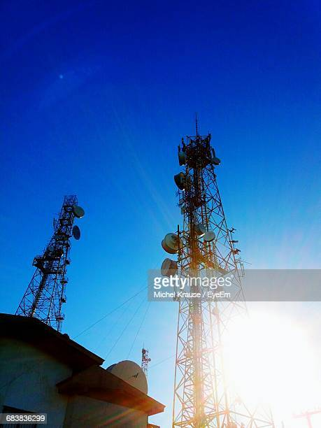 Low Angle View Of House And Communications Towers During Sunny Day