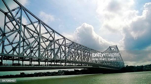 Low Angle View Of Howrah Bridge Over Hooghly River