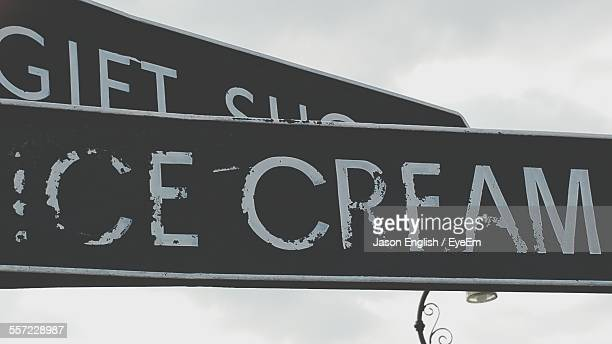 Low Angle View Of Ice Cream Sign Against Sky