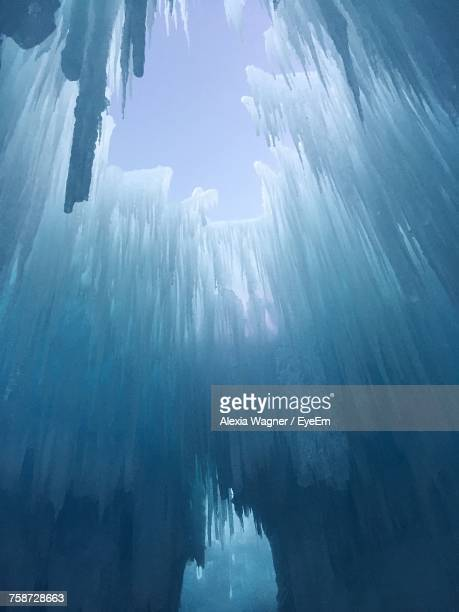 Low Angle View Of Icicles Against Sky During Winter