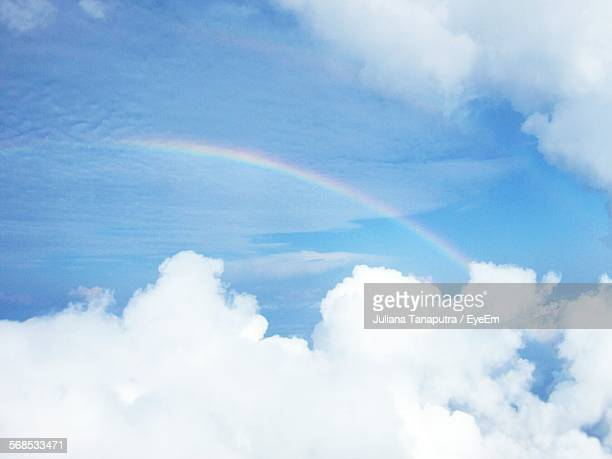 Low Angle View Of Idyllic Rainbow In Cloudy Sky