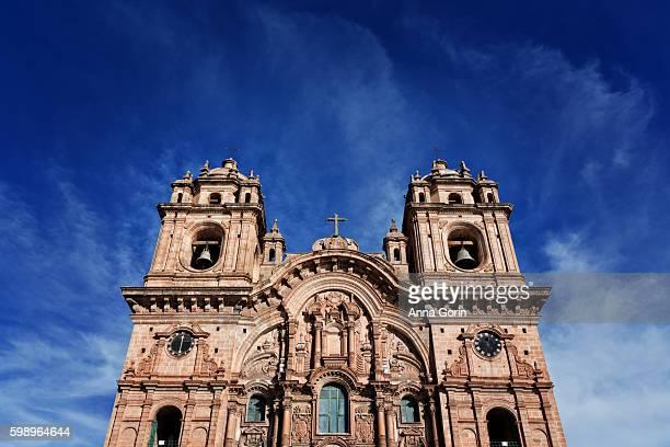 Low angle view of Iglesias de la Compania de Jesus facade on spring afternoon in Plaza de Armas, Cusco, Peru