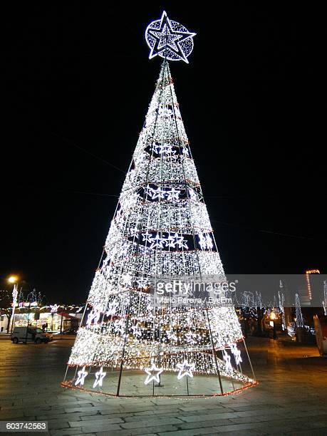Low Angle View Of Illuminated Artificial Christmas Tree At Night