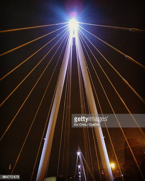 Low Angle View Of Illuminated Cable-Stayed Bridge At Night