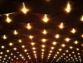 Low Angle View Of Illuminated Ceiling Lights