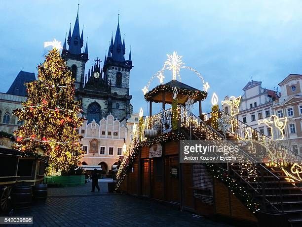 Low Angle View Of Illuminated Christmas Tree In Front Of Tyn Church Against Sky At Dusk