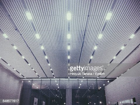 Low Angle View Of Illuminated Corridor In Building