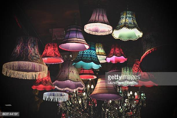 Low Angle View Of Illuminated Lamps On Ceiling
