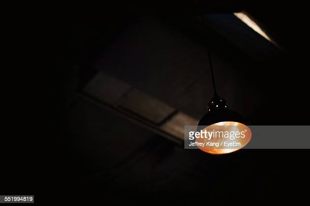 Low Angle View Of Illuminated Light Hanging On Ceiling