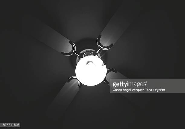 Low Angle View Of Illuminated Light On Ceiling Fan