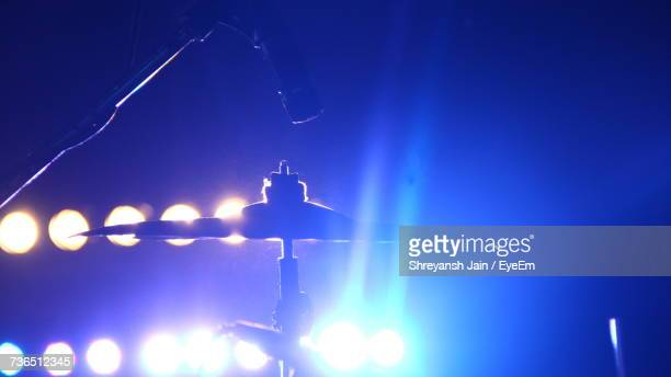 Low Angle View Of Illuminated Lighting Equipment Against Blue Sky