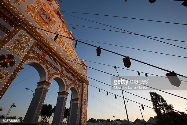 Low Angle View Of Illuminated Seville Fair Entrance Against Sky