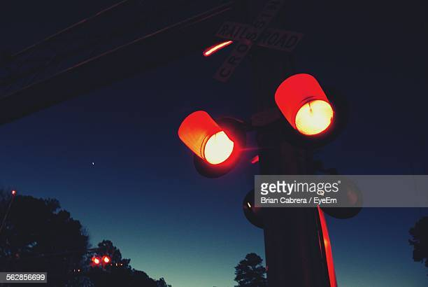 Low Angle View Of Illuminated Stoplight At Night