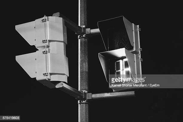 Low Angle View Of Illuminated Stoplight During Night