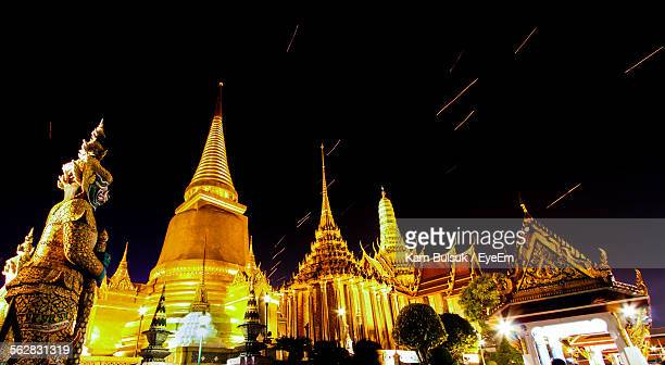 Low Angle View Of Illuminated Temple At Wat Phra Kaeo