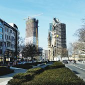 Low Angle View Of Incomplete Buildings And Kaiser Wilhelm Memorial Church