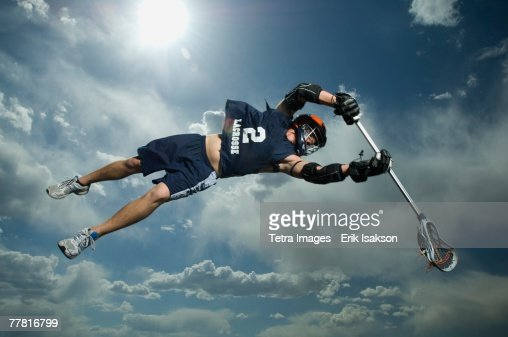 Low angle view of jai-alai player jumping : Stock Photo