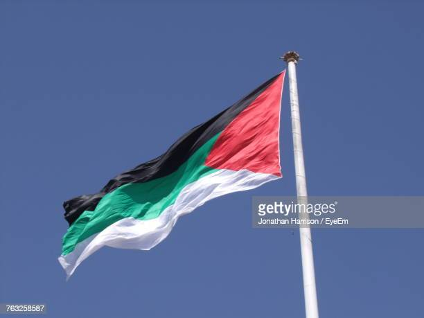 Low Angle View Of Jordan Flag Against Clear Blue Sky