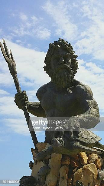 Low Angle View Of King Neptune Statue Against Sky