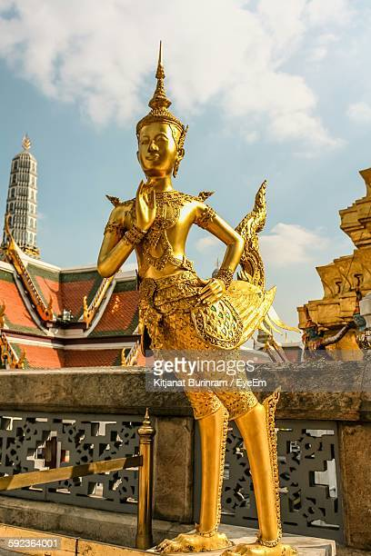 Low Angle View Of Kinnara Statue At Wat Phra Kaeo
