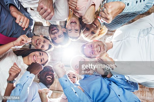 Low angle view of large group of successful business people.