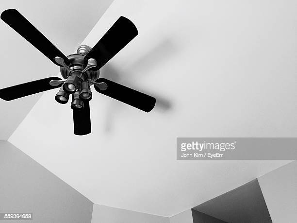 Low Angle View Of Light Fixtures On Ceiling Fan