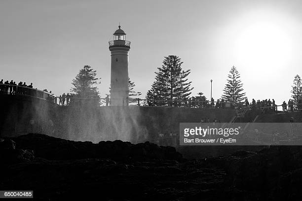 Low Angle View Of Lighthouse Against Sky At Kiama Blowhole On Sunny Day
