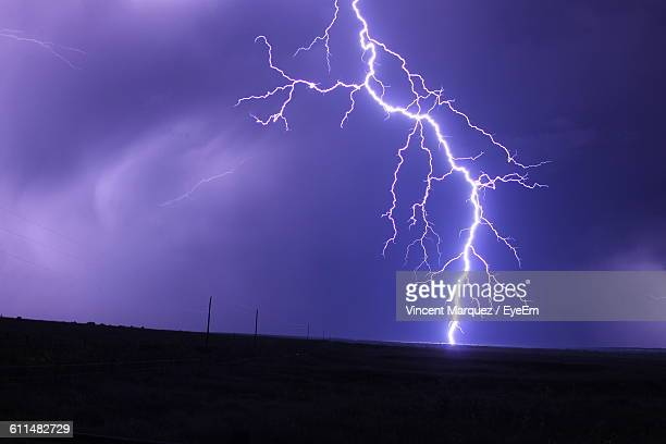 Low Angle View Of Lightning Against Cloudy Sky