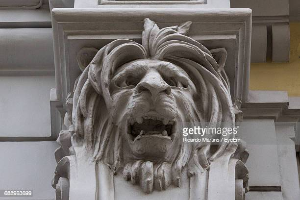 Low Angle View Of Lion Sculpture On Building