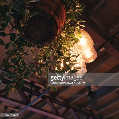 Low Angle View Of Lit Lamp At Ceiling