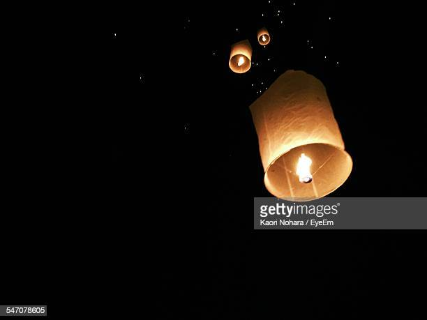 Low Angle View Of Lit Lanterns At Night