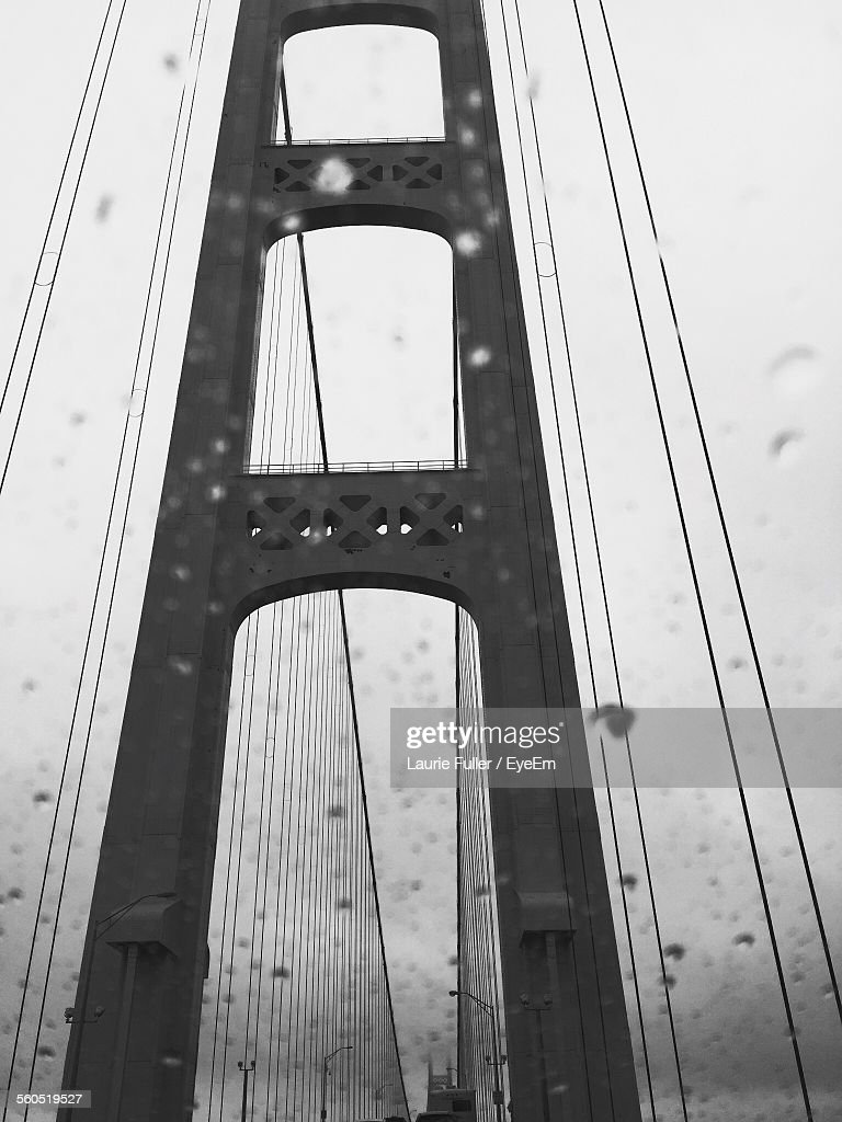 Low Angle View Of Mackinac Bridge Against Sky Seen Through Windshield