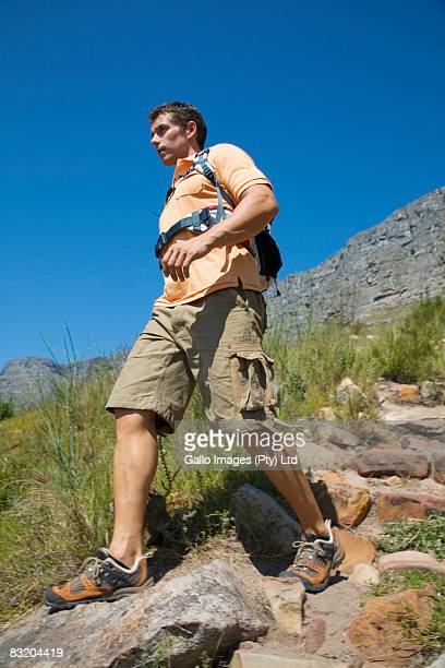Low angle view of man coming down Table Mountain, Cape Town, Western Cape Province, South Africa