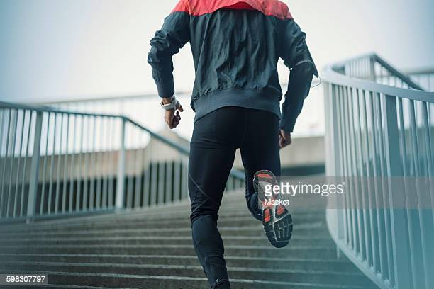 Low angle view of man running on steps