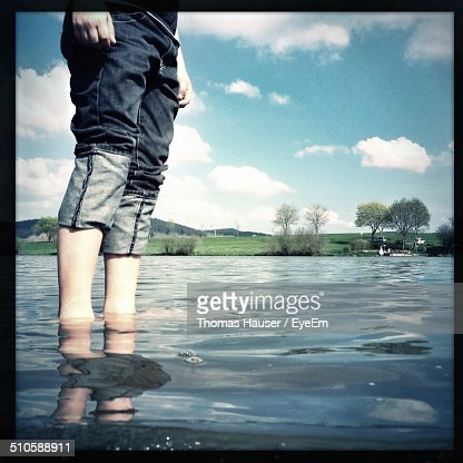 Low angle view of man standing in water