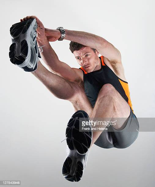 Low angle view of man stretching