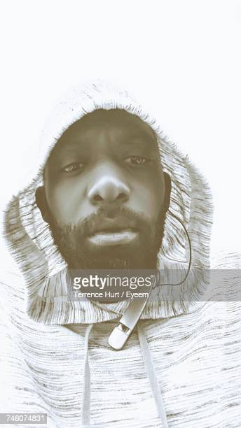 Low Angle View Of Man Wearing Hood Against White Background