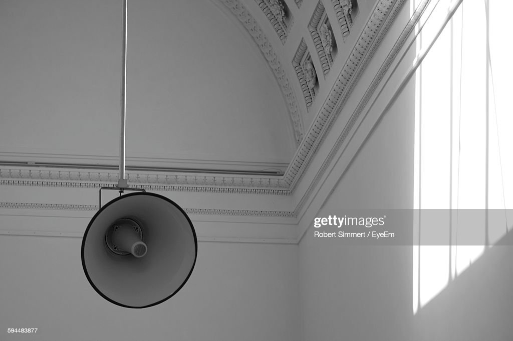 Low Angle View Of Megaphone Against Wall