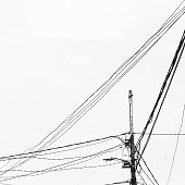 Low Angle View Of Messy Telephone Pole Wires Against Sky