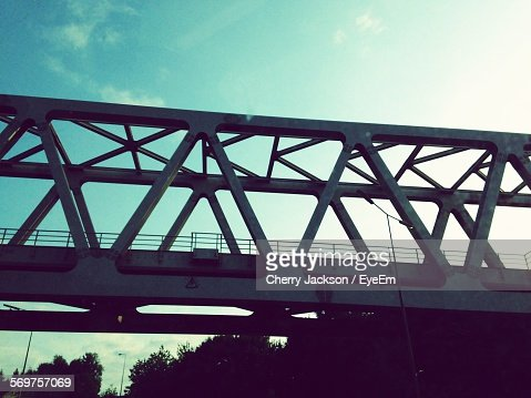 Low Angle View Of Metal Bridge Against Sky