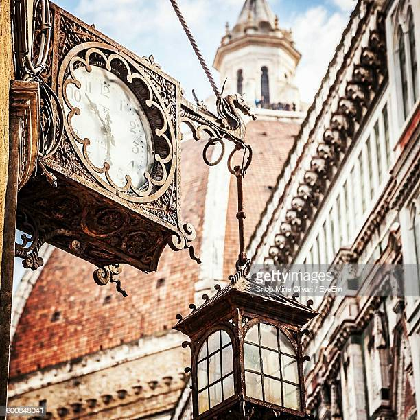 Low Angle View Of Metallic Lantern Hanging On Clock Against Florence Cathedral