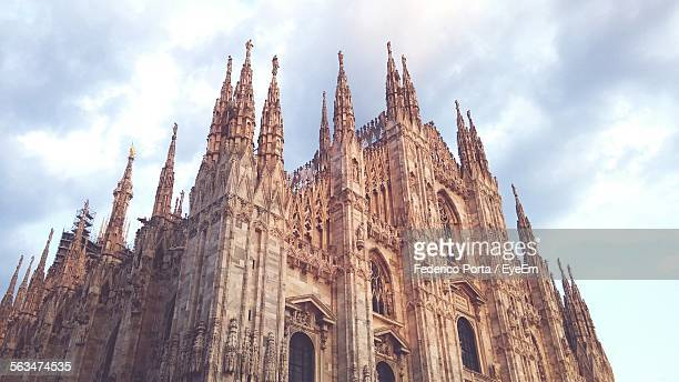 Low Angle View Of Milan Cathedral Against Cloudy Sky