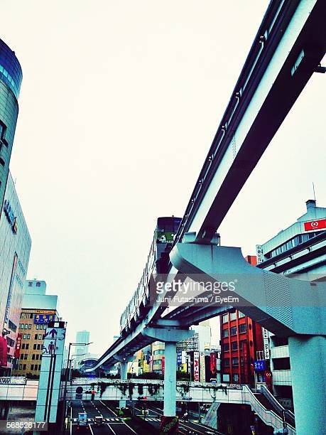 Low Angle View Of Monorail Against Sky In City