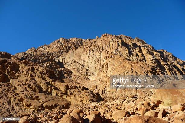 Low Angle View Of Mountain Against Clear Blue Sky
